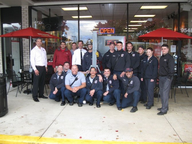 Members of the City of Fairfax Fire Station 403: (back row): Shane Mitchell, Roger Hundal, Clinton Haynes, Dave Rohr, Joe Waters, Page Whitacre, Joshua McCoin, Keith Virts, Daniel Richardson, Jessica Merrill and Dan Lowe. (Front row): Jason Gorres, Joe Charley, Allen Nicholson, Ronald Teribery, John Jeniec and Henry Requejo.