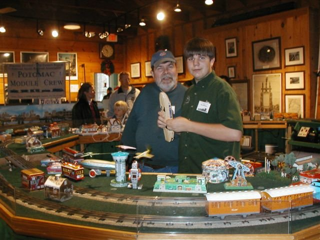 Gil Baldwin and his son, Ben, members of the National Capitol Trackers O Scale Train Club, pictured at the Fairfax Station Railroad Museum's Holiday Model Train Show.
