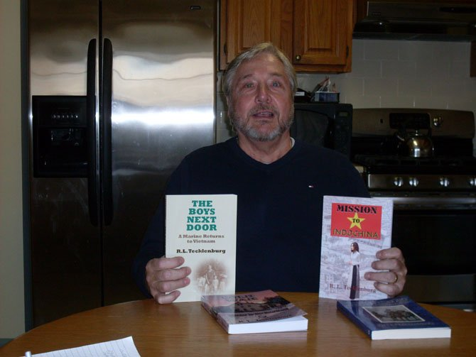 Bob Tecklenberg with his books.