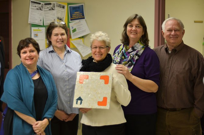 "From left, Council for the Arts of Herndon Director Signe Friedrichs, Anita Damron, Gail Greenberg, Susan Alger and Leroy ""Ivan"" Young at the Reston Embry Rucker Shelter."