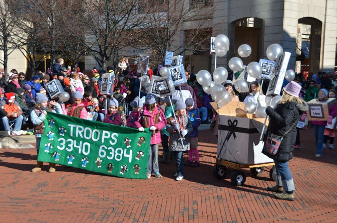 "The theme of the parade at Reston Town Center this year was ""Destination: Reston,"" and many groups used the transportation theme, including Girl Scout Troops 3340 and 6384, which recognized the soon-to-come Silver Line."