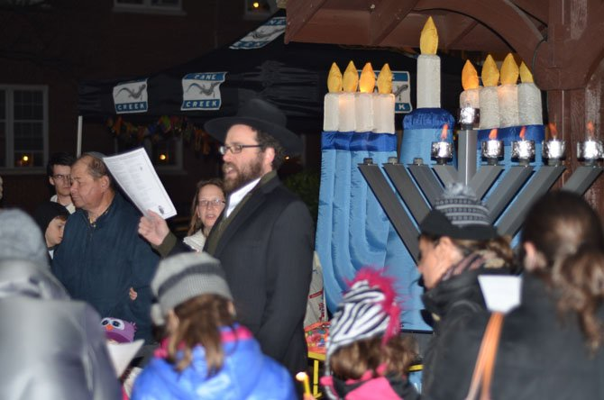 More than 50 persons attended the evening celebration of Chanukah at the Herndon Town Square on Sunday. Afterwards everyone was invited to enjoy latkes and donuts.