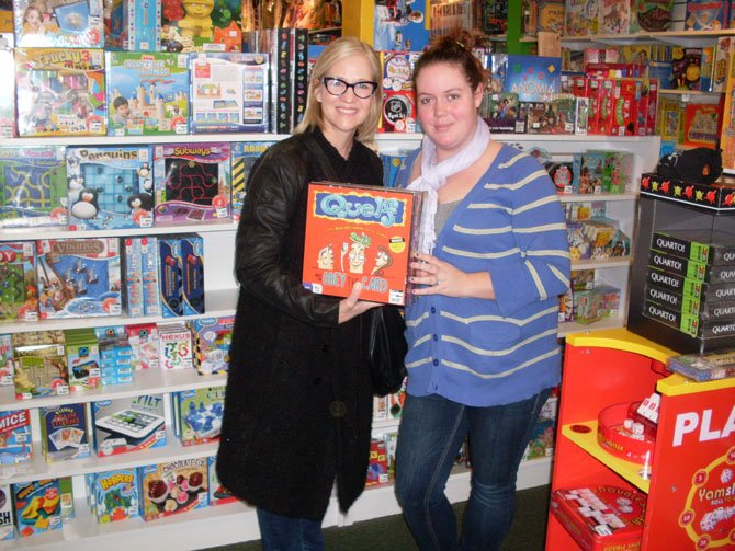 Customer, Michele Hopkins, and Molly Gilroy, sales associate, at Child's Play Toys.