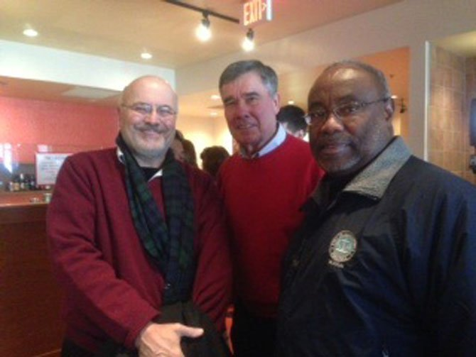 Gil Kerlikowske, (center) director of National Drug Control Policy, with Alexandria Chamber of Commerce CEO John Long and Mayor Bill Euille during a visit to Del Ray's Holy Cow restaurant Nov. 30 as part of Small Business Saturday.