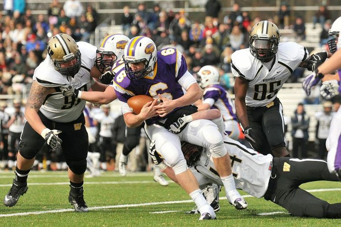 Lake Braddock quarterback Caleb Henderson is wrapped up by Westfield defensive lineman Timothy Curry.