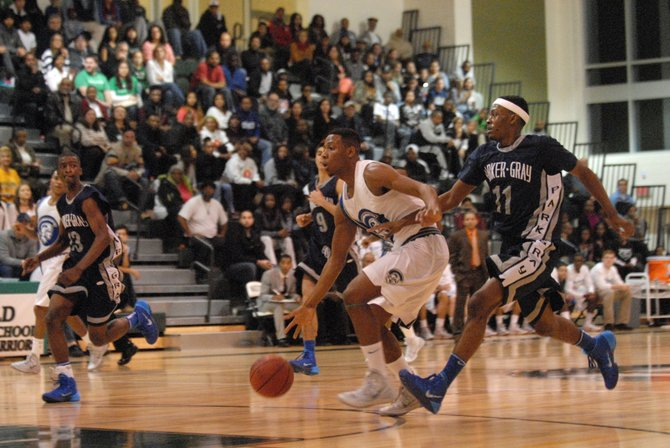 Wakefield senior Re'Quan Hopson, with ball, scored 19 points and grabbed 12 rebounds against T.C. Williams on Dec. 7.