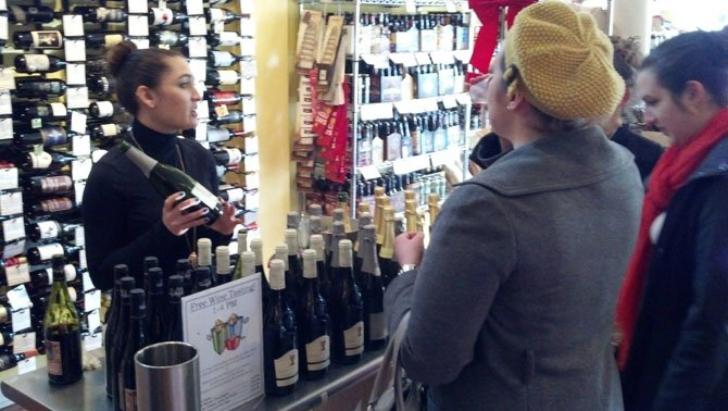 Missy Pankow, front-of-house manager at the Del Ray location of Cheesetique, lead a wine tasting last weekend to help customers get to know some new varieties.