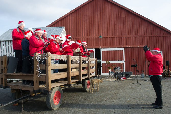 The Fairfax Jubil-Aires provide entertainment during the 'Old Fashioned Holiday at the Farm' celebration held at Frying Pan Farm Park on Dec. 7.