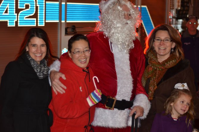 From the left Herndon Town Council member Melissa Jonas, Town Council member Grace H. Wolf, Santa Claus, Mayor Lisa Merkel, and Lila Merkel.