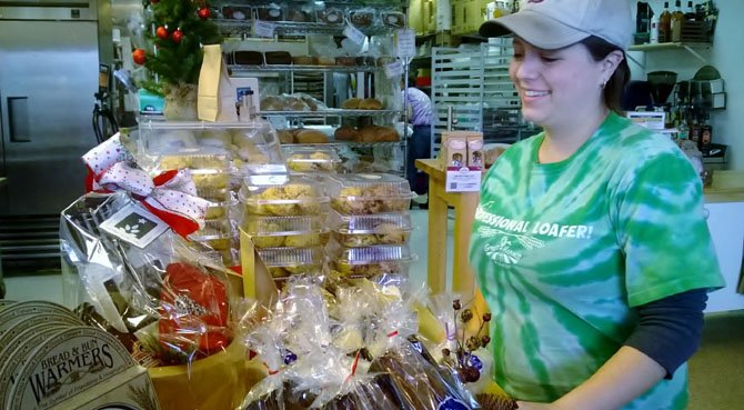 Manager Sam Gray organizes baked goods that can be included in a holiday gift package.