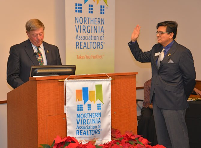 Thomas Stevens, past Chair of the NVAR, administers the oath of office to Mario Rubio, in-coming Chairman of the Board.
