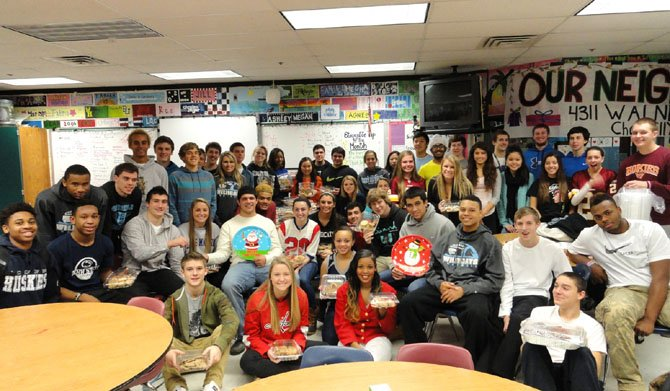 Some of Centreville High's SGA members gathered for a photo after packaging all their cookies for Our Neighbor's Child.