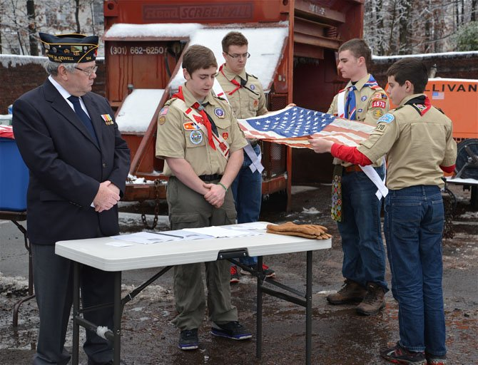 The First Flag for retirement is presented. Once presented and inspected, scout Patrick Nugent took the flag to the fires.