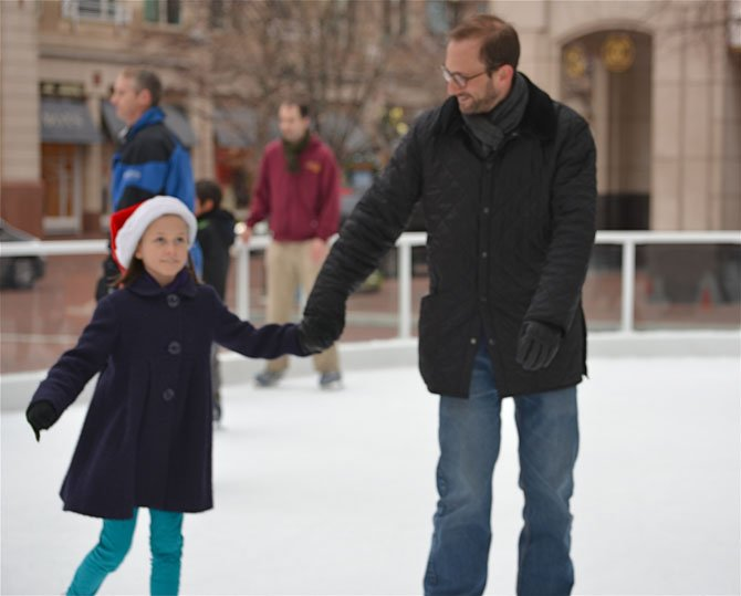 "Lila Sheingate hangs on to dad Adam. The pair came in from Baltimore to visit Reston relatives. When asked if Miss Lila thought she was ready for Sochi, she replied, ""Well, maybe!"" Confidence is key."