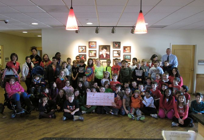 Vienna Elementary fourth graders presenting a check of $2,156.09 to Jill's House.