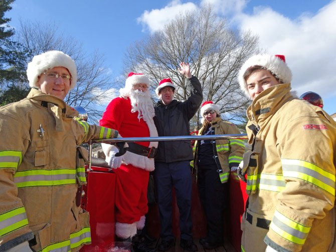 "Bill Sonntag, with Santa, is the biggest fan of the Vienna Volunteer Fire Department.  Santa and his elves made a special trip to pick up Bill for the launch of the 2013 ""Santa Run.""  Bill's parents say the VVFD volunteers all go well out of their way to look out for the people of the community."