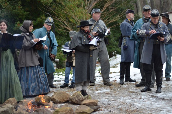 Members of the Virginia 49th Infantry, a family-oriented Civil War living history and reenactment organization, returned to Colvin Run Mill to sing Christmas carols.