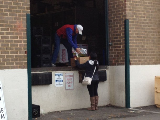 A woman picks up her monthly food donations from Food for Others in Fairfax.