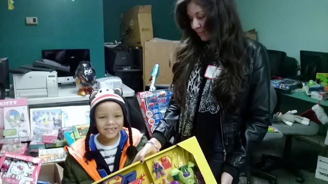 Neyda Lugunes-Loza, 13, helped Jason, 6, pick out a gift for his brother at the FACETS Holiday Sibling Shop.