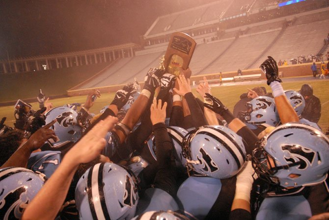 The Centreville football team celebrates after beating Oscar Smith 35-6 in the Group 6A state championship game on Dec. 14 at UVa's Scott Stadium.