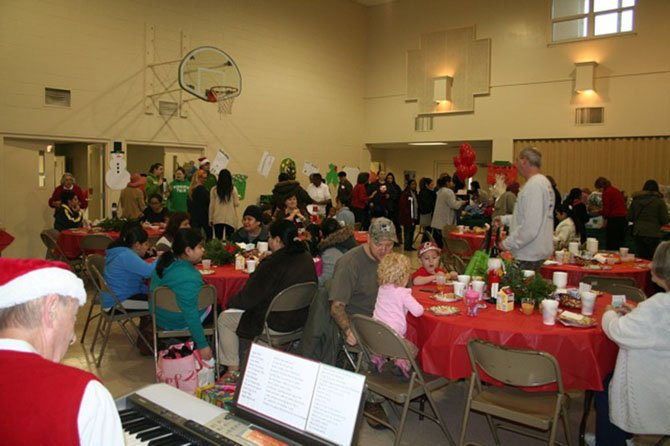 More than 150 Share client families, supported by about 50 Share volunteers, participated in the festive celebration.