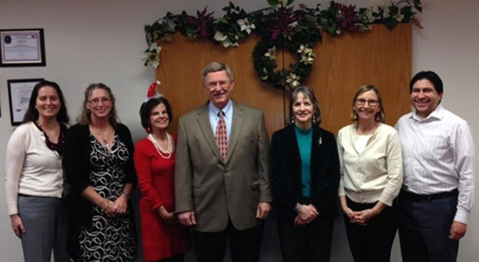 Supervisor Foust (in the middle) with his office staff. From left: Patty Dinkelmeyer, Jenny Phipps, Jane Edmondson, Donna Keefe, Julie Ide, Nen Wiles.