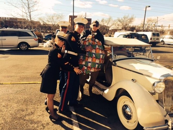 Phil Williams and three Marines unloading toys from Williams's 1959 MG at the Juke Box Diner.