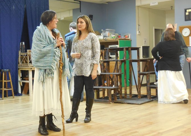 An old woman (Susanna Todd) offers to buy Fantine's (Jennifer Lambert) necklace in Reston Community Players' rehearsal of 'Les Miserables.'