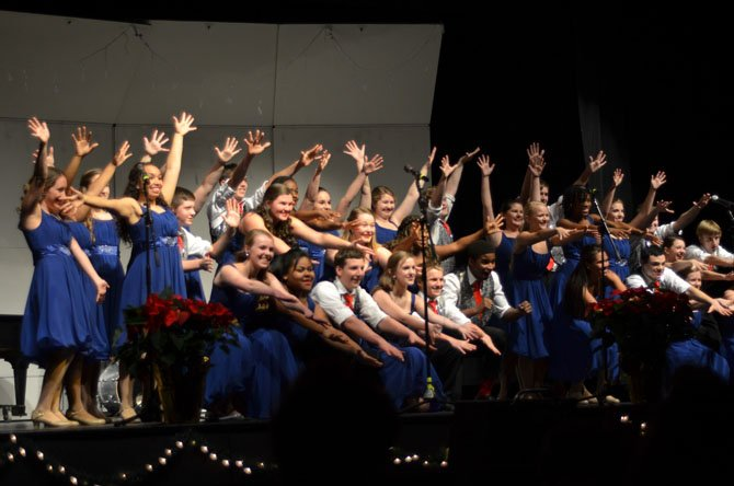 Jazz hands provided by the Herndon High Heat Wave Show Choir at their annual Winter Choir Concert.