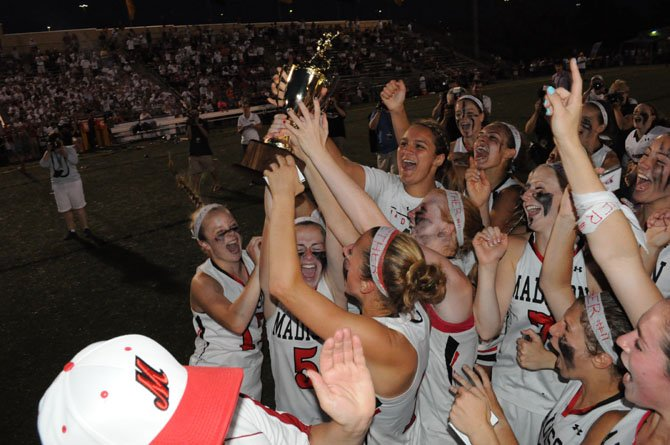The Madison girls' lacrosse team won the 2013 state championship.
