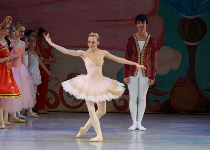 South Lakes senior Rebecca Mattern takes a final bow in her last performance in the Conservatory Ballet's annual production of The Nutcracker.