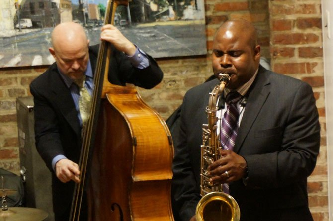 Saxophonist Vaughn Ambrose performs at the Principle Gallery as part of First Night Alexandria.
