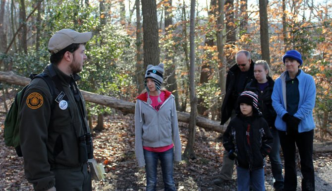 Kevin Koons, left, speaks to participants in the First Day Hike, including the Houck family of Burke.