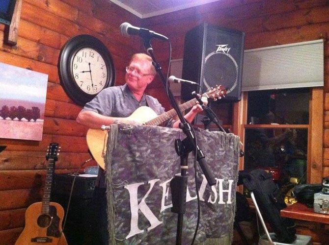 Glen McCarthy playing guitar with the Irish band, Keltish.