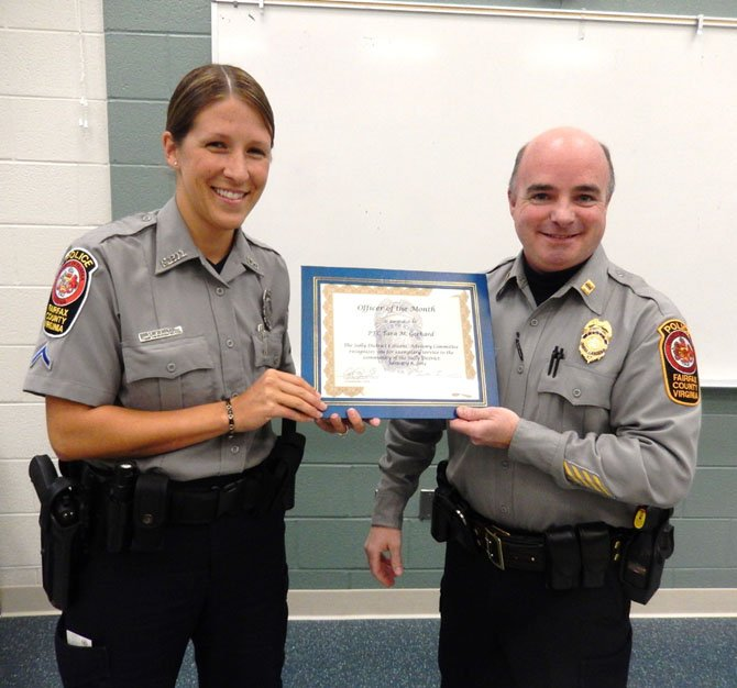 PFC Tara Gerhard receives her award from Capt. Ed O'Carroll.