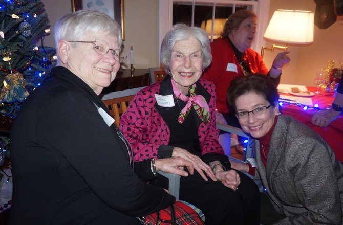 Betty Jo Middleton, Resa O'Flaherty and Marcia Speck attend the traditional Women's Sherry Party Dec. 15 at the home of Arthur Peabody and Lucy Thomson. This year's party was in tribute to founders Vola Lawson and Lois Walker, who died earlier last year.