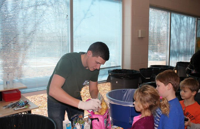 Aaron Srance of Lorton volunteers during Silverbrook Elementary School's lunch recycling program.