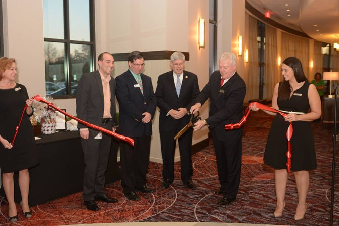 New businesses continue to open in Springfield. From left: Ann Vandehey, DOS Embassy Suites Springfield; Taylor Holland, chief of staff for Lee District Supervisor; Michael Drobnis, 2013 president Greater Springfield Chamber of Commerce; Dean Miller, National Sales Manager Visit Fairfax; Brad Wymer, GM Embassy Suites Springfield; and Francesca deVito, Catering Sales Manager Embassy Suites Springfield