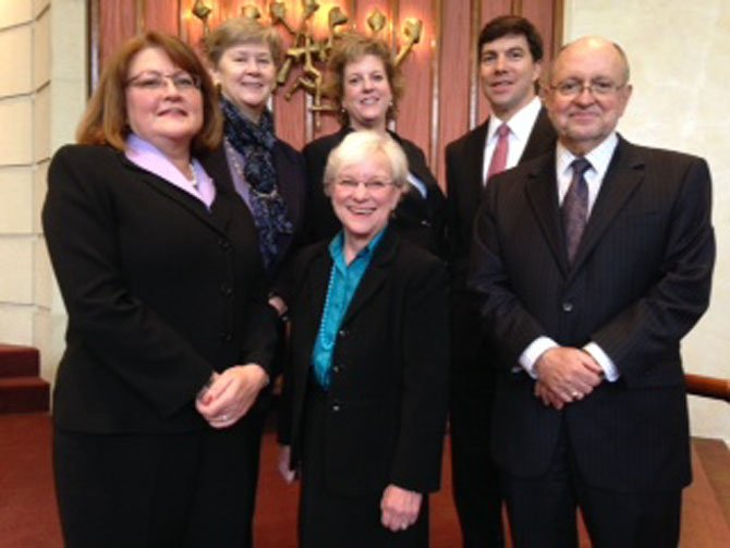 Front row, from left, Kim Fish, Fiske and Harvey, PLLC; Sally Hurne, AARP, and John Porter, executive director, ACT for Alexandria. In second row: Mary Lee Anderson, executive director, Senior Services of Alexandria; Laurie Blackburn, Speck Caudron/Well Fargo, and Tristan Caudron, Speck Caudron/Wells Fargo.