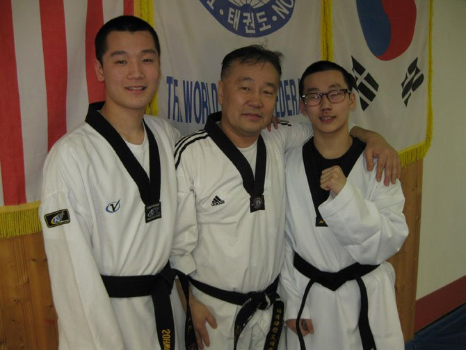 From left: Sohwon, 17, and Siwon Kim, 15, with their dad Master Han Kim.