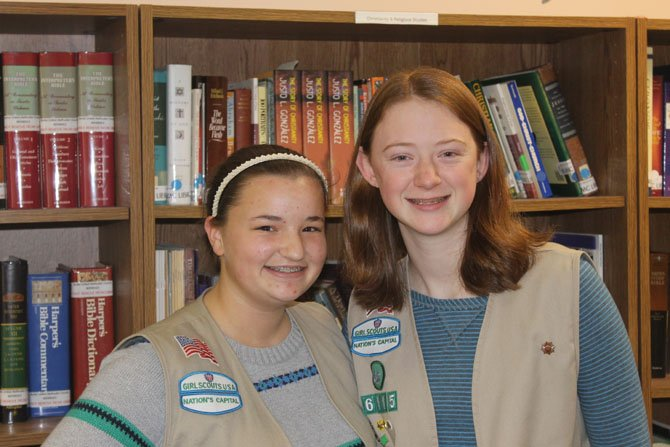 Girl Scouts Emma Henderson and Rylie Smedley, both Fairfax County residents, have spent countless weekends raising money for their trip to Europe.
