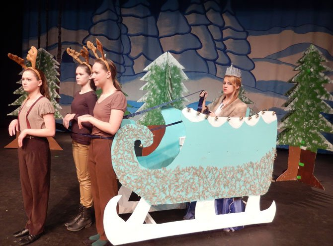 Reindeer (from left) Marybeth Myers, Jordyn DeLong and Sophia Zmorzenski pull the Snow Queen (Olivia Hays) in her sleigh.