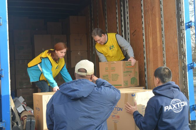 Volunteers load boxes of blankets into a truck at an LDS church in Vienna.