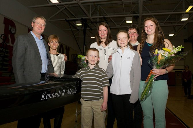 Friends and family members of Ken Meade gathered in the McLean High School gymnasium on Saturday, Jan. 10 for the christening of the newly acquired Resolute racing shell named in honor of Ken Meade, father of Cammie and Allie Meade who rowed for the McLean High School Crew Club (MCC).