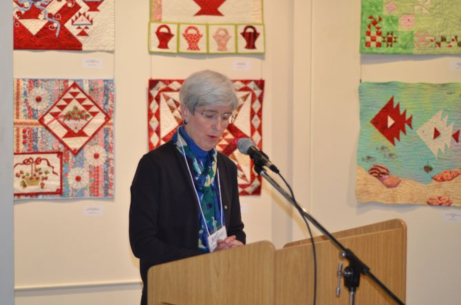 Dorry Emmer, a resident of Great Falls speaks briefly at the ArtSpace Herndon's artists reception.
