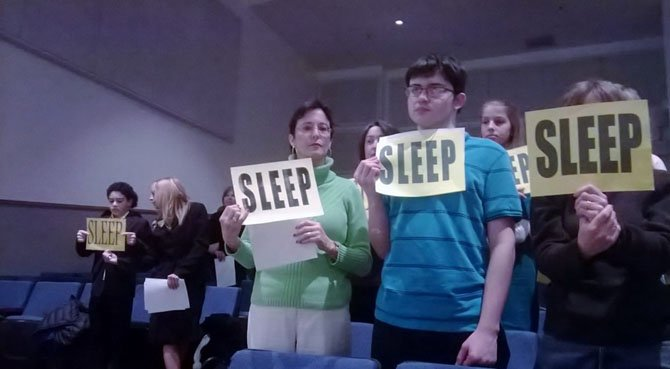 SLEEP advocates gather at a school board public hearing. The Fairfax County School Board is examining options for later start times, to be implemented in 2015.