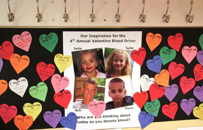 During last year's blood drive, donors and children were given paper hearts to write reasons why they were giving blood.