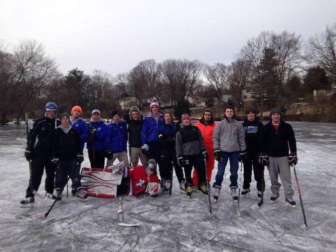 The Bishop O'Connell Varsity Hockey Team members have some fun in the freezing temperatures.