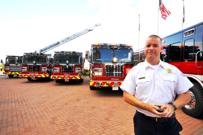Alexandria Fire Chief Adam Thiel in front of new equipment last year.