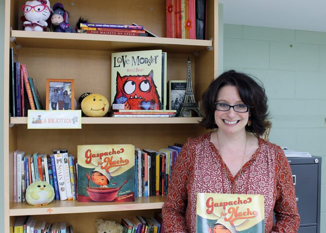 "Tracey Kyle, a Spanish teacher at Key Middle School in Franconia, holds her recently published book. Kyle has been working on ""Gazpacho for Nacho"" since 2008."